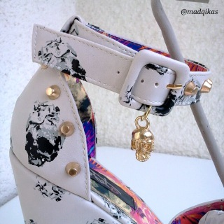Details of Strap, Gold Charm, and Print